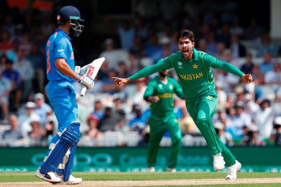 Amir khan celebrating his wicket during match